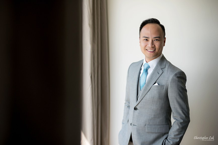 Christopher Luk - Toronto Wedding Lifestyle Event Photographer - Photojournalistic Natural Candid Hilton Suites Markham Groom Getting Ready Indochino Suit Grey Vest Blue Tie Portrait