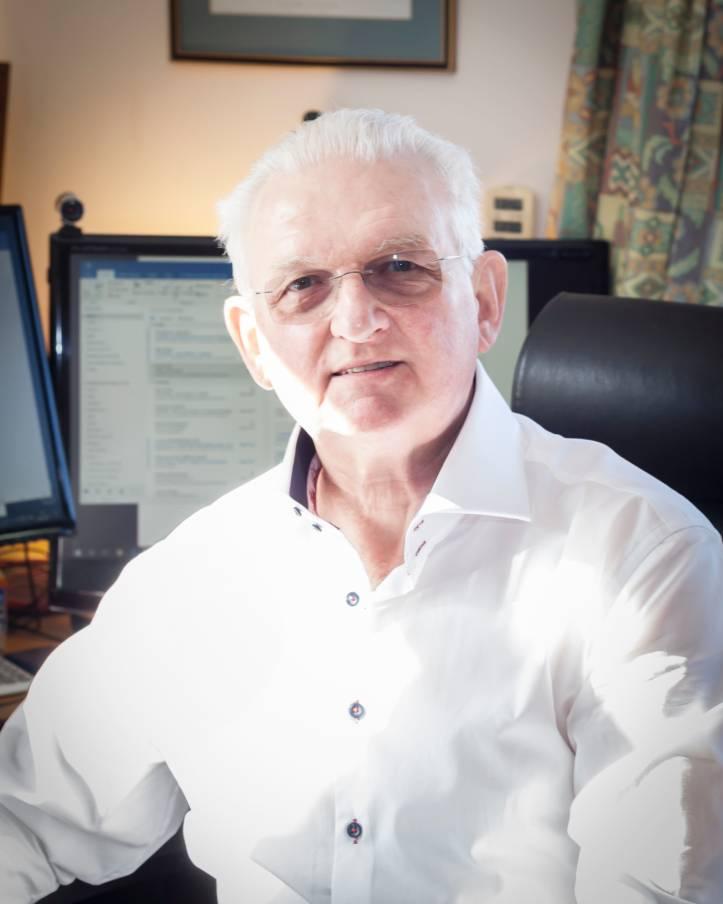 Chris Makin Mediator at his desk