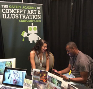 Justin Copeland reviewing story artist Marissa Livingston's portfolio at the Oatley Academy booth during CTNX 2013.