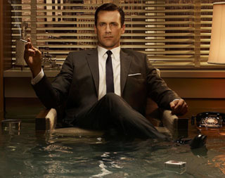 Smarmy salesman, Mad Men's Don Draper about to drown as his office fills with water.