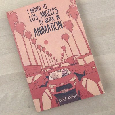 "Cover image for Disney Storyboard Artist Natalie Nourigat's graphic novel: ""I Moved to Los Angeles To Work In Animation."" A cartoony illustration in pink monochrome of a young woman, stuck in a traffic jam, alone in her car. Palm trees and vehicles extend into the distance."