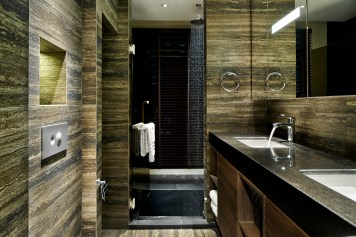 Interior design photography showing bathroom with shower and sinks at simei rise condo in singapore