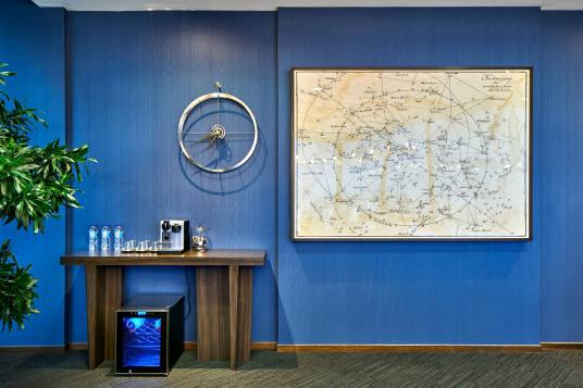 Interior Photography of the sky premium singapore boardroom wall with map and coffee maker