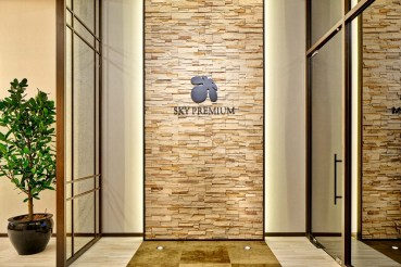 360 degree virtual tour photo of sky premium main entrance in Singapore with logo on wall