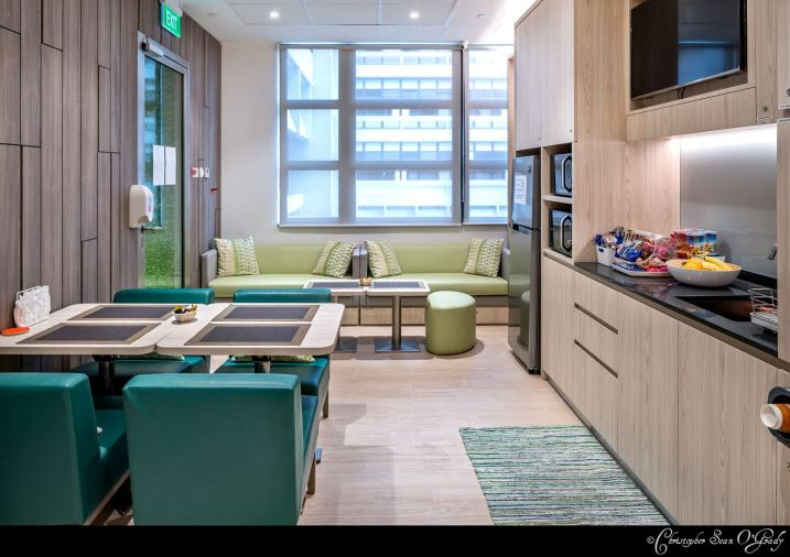 Interior Photography of the Ronald Mcdonald House Singapore showing couches and dining area