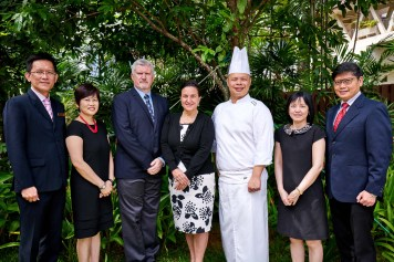group photography of senior staff at tanglin club in singapore