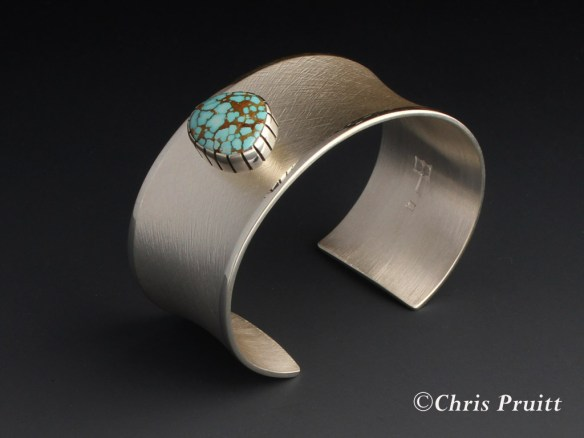 Sterling silver, anticlastic,cross hatch textured bracelet with raised natural #8 turquoise cabochon