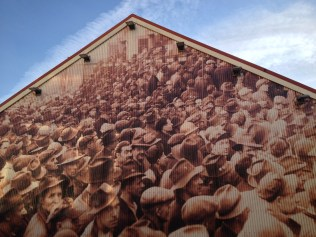 A large photo mural on the side of one of the restored buildings on site, shows the magnitude of the yard's operations back in its heyday. Chris Slater photo.