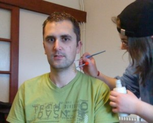 Special effects for Terror of the Killer Carnivorous Coat - Chrissey uses a paintbrush to add liquid latex to the actors neck