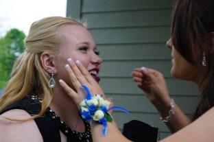 Final touchups on makeup.