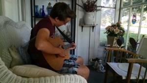 Hudi playing the guitar
