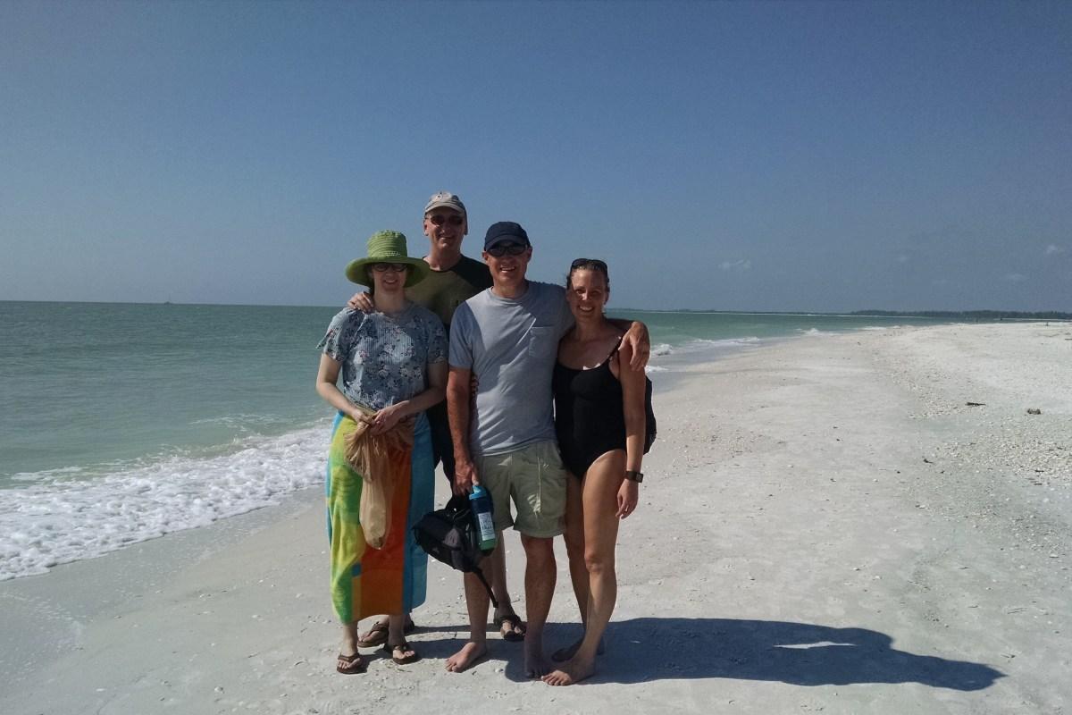 Friends hiking the beach