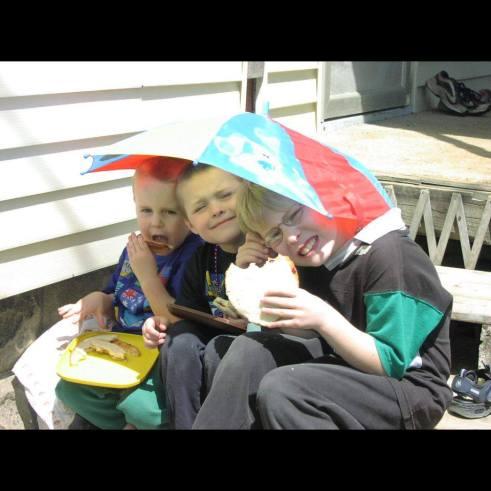 Brothers under umbrella