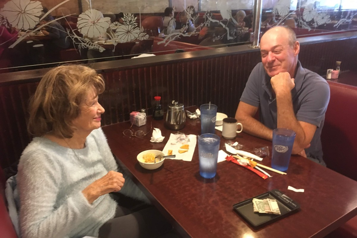 Chris and Mom conversing over lunch