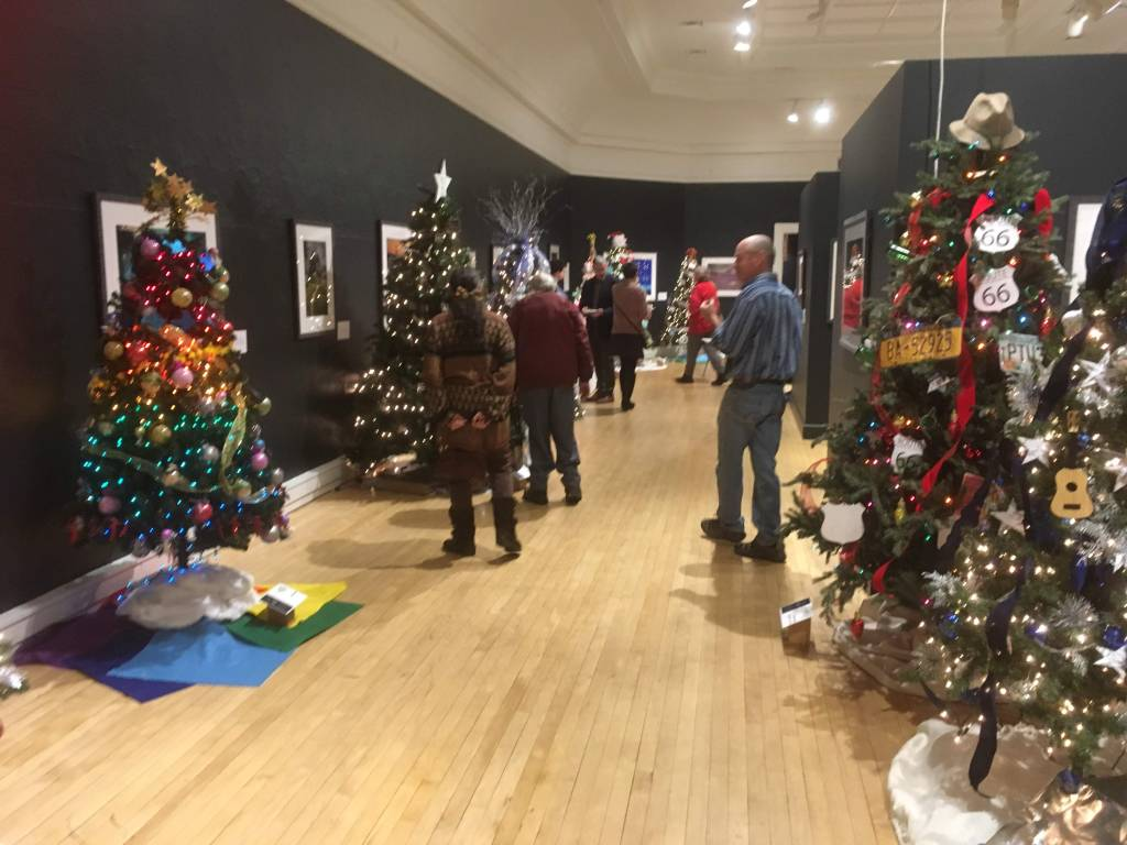 "Local businesses created trees based on songs. It was up to us to figure out while songs each tree represented. See that one on the left? It's ""Somewhere Over the Rainbow."""