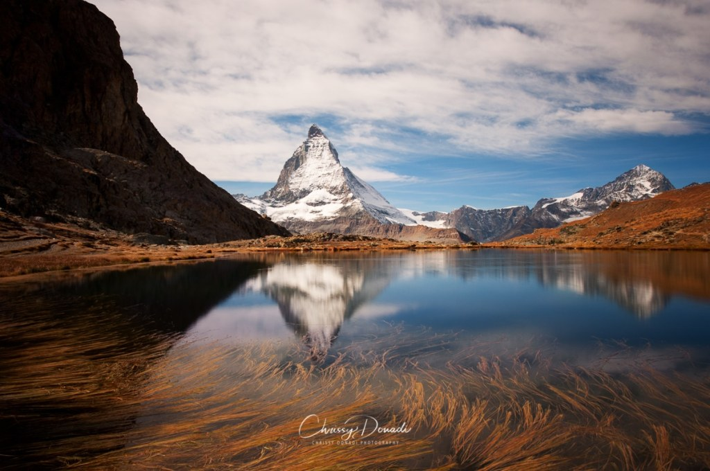 The stillness of an autumn lake with the reflection of the Matterhorn in Zermatt, Switzerland