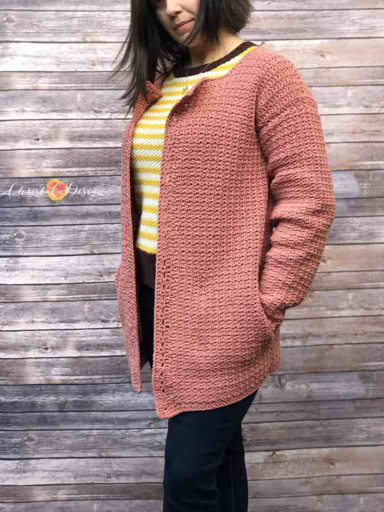 picture of woman in pink cardigan crocheted with in seam pockets
