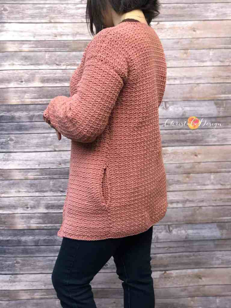 picture of woman in crochet cardigan turned away with long length