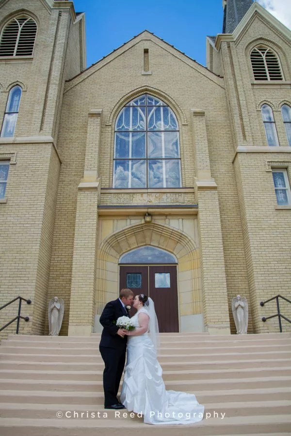 bride and groom at st john lutheran church in belle plaine