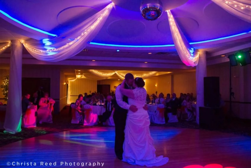 first dance with a mirror ball and purple lights in chaska