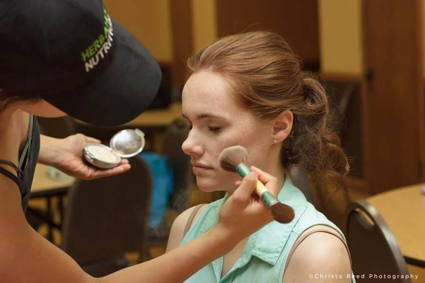 A picture of the bride getting her make up done by Mankato wedding photographer
