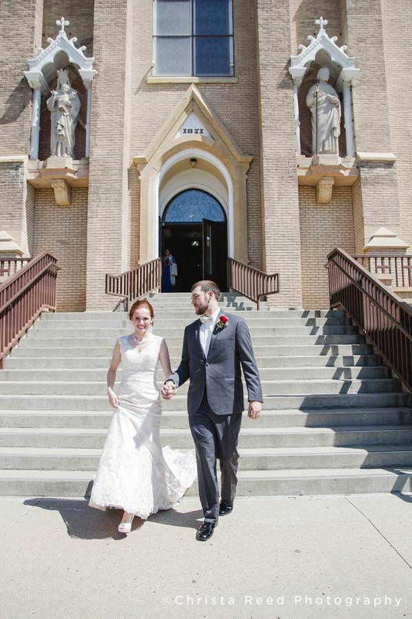 couple leaves the church in mankato after their wedding