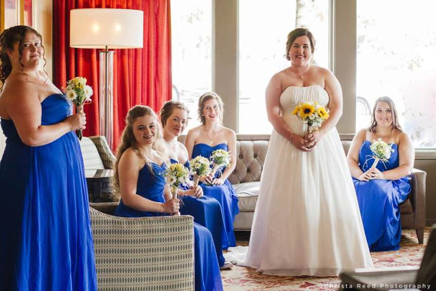 bride with maids of honor wearing blue dresses
