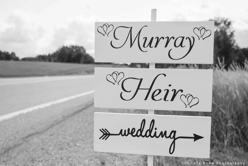 wedding sign with calligraphy and hearts
