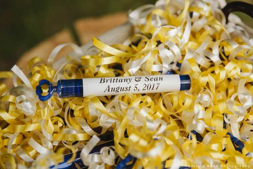 wedding bubbles with gold ribbons