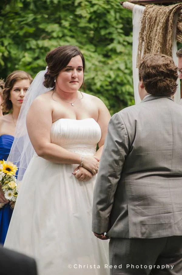 bride faces groom during ceremony