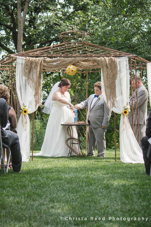 bride and groom have outdoor sand ceremony