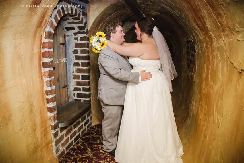 couple in wine cellar at chanhassen wedding