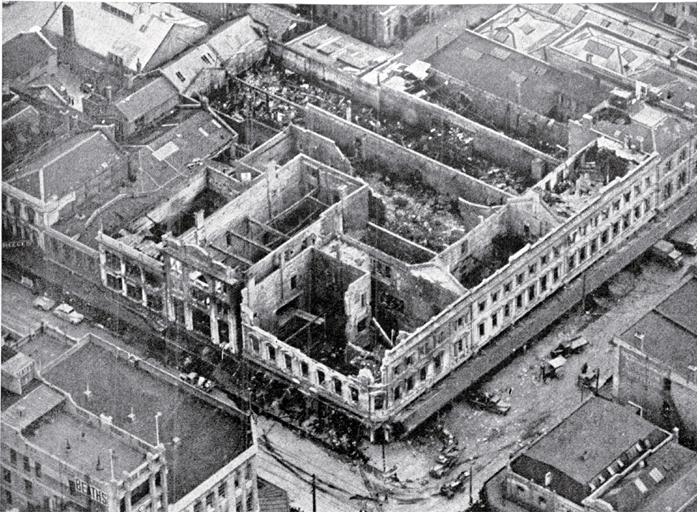 Aerial view of the gutted shell of the three-storied department building [20 Nov. 1947]