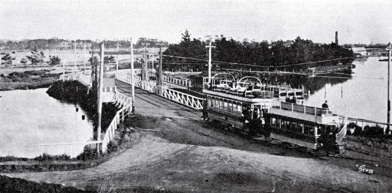 An electric tram crosses the Ferry Bridge over the Heathcote River on the road to Sumner, Christchurch [1909]