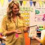 Lorie Reynolds receiving the award