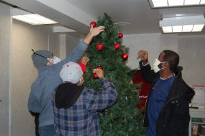 Patients decorating Christmas tree