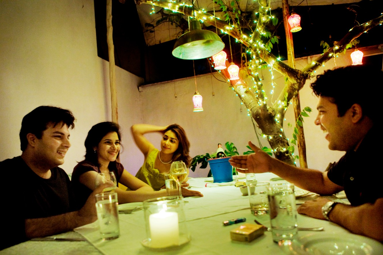 The upper class relax with white wine in the softly lit tapas bar, Olive, in the old textile district of Bangalore. The booming concentration of business activity breeds a sophisticated, cosmopolitan outlook with fancy restaurants and nightclubs.