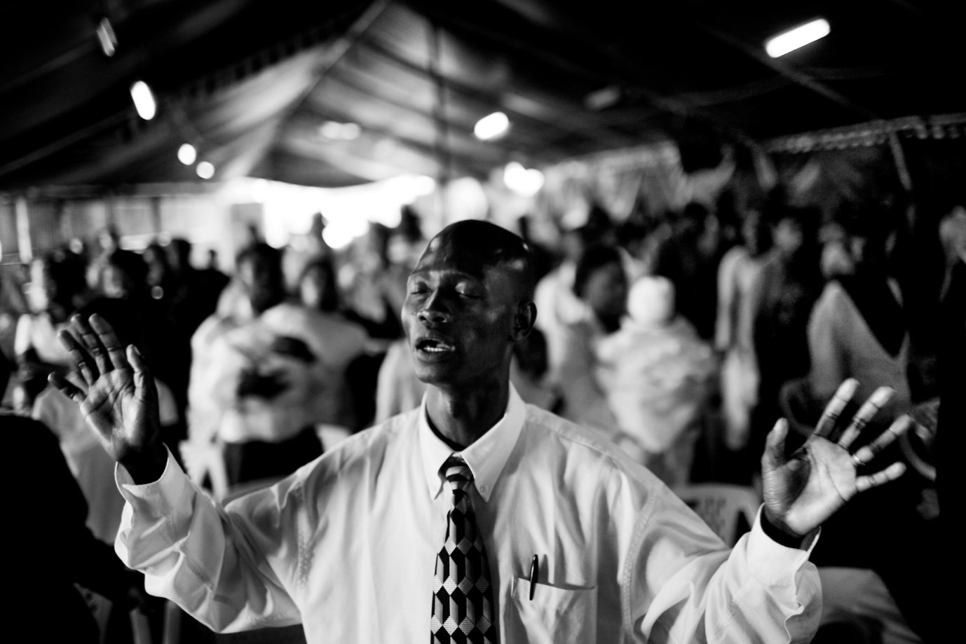 A worshipper in Cathedral of Praise Ministry Church.