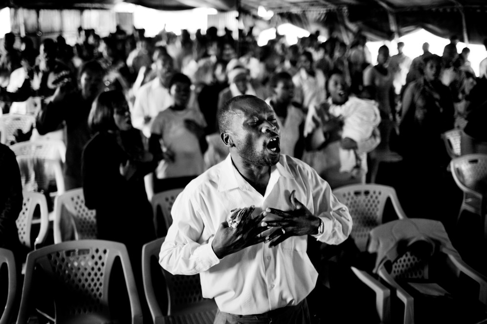 Pastor Richard Ouya in Cathedral of Praise Ministry Church.