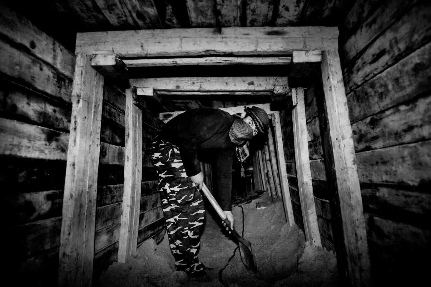 The narrow, secret tunnels used for smuggling goods, arms and people across the border at Rafah under the border between Egypt and Gaza. About 80 percent of the tunnels was supposed to be destroyed or damaged in the three-week Israeli airstrike of Gaza, but a week after they are in the process of being repaired. Ahmed, who will remain anonymous, is deep within a damaged tunnel to dig it out.