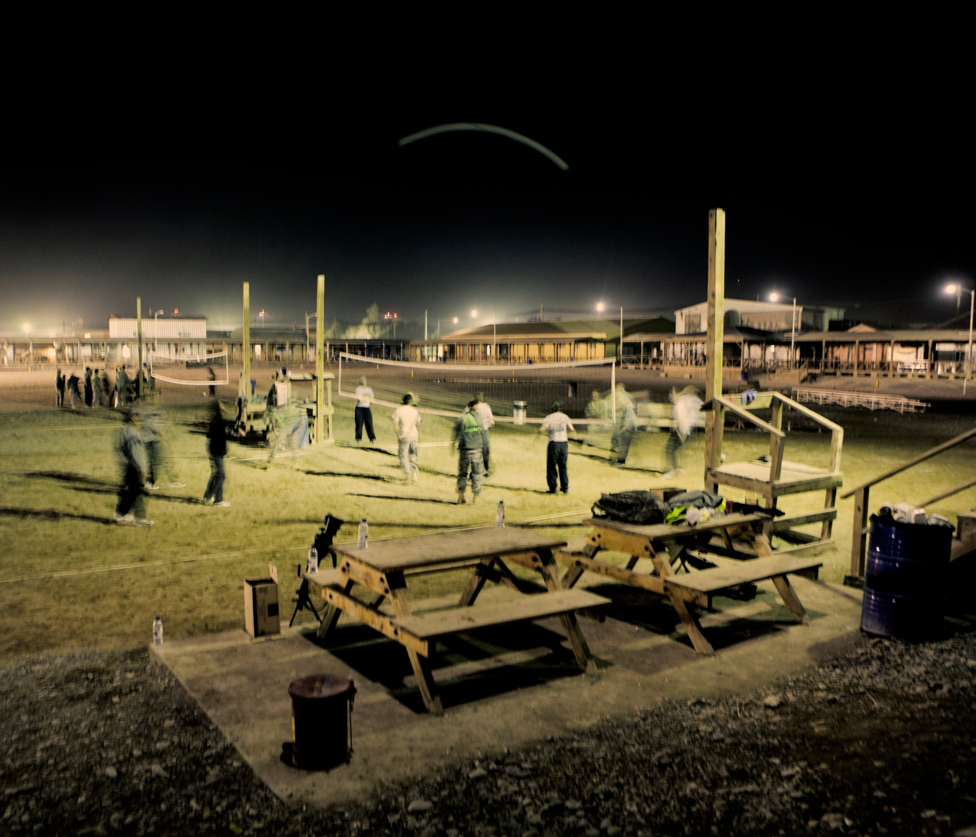 Soldiers play volleyball at night in Camp Bastion. In June 2011, President Obama announced his plan to begin the withdrawal of US troops from Afghanistan, but there is currently no end date for the war in the troubled country. Helmand is the largest province in Afghanistan, and the heart of the war against terror. Commanders on the ground have described the situation as the most brutal conflict the British Army has been involved in since the Korean War. Much of the fighting between NATO and Taliban forces is taking place in this province and Helmand is a true Taliban stronghold. The Helmand River flows through the mainly desert region. With these images I am trying to show a softer side to this troubled area of Afghanistan.