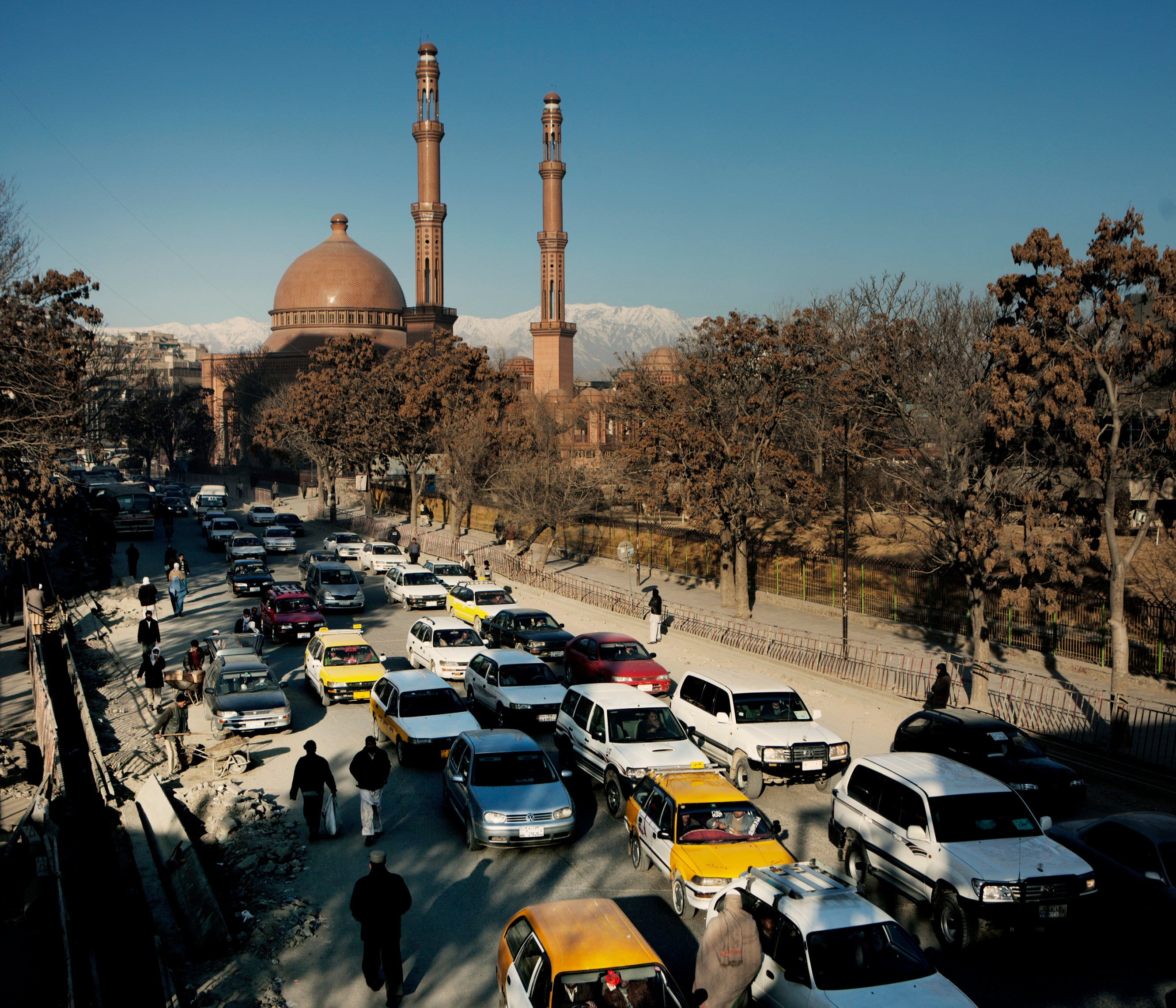 Heavy traffic in a street outside the Abdul Rahman Mosque. In June 2011, President Obama announced his plan to begin the withdrawal of US troops from Afghanistan, but there is currently no end date for the war in the troubled country. Helmand is the largest province in Afghanistan, and the heart of the war against terror. Commanders on the ground have described the situation as the most brutal conflict the British Army has been involved in since the Korean War. Much of the fighting between NATO and Taliban forces is taking place in this province and Helmand is a true Taliban stronghold. The Helmand River flows through the mainly desert region. With these images I am trying to show a softer side to this troubled area of Afghanistan.