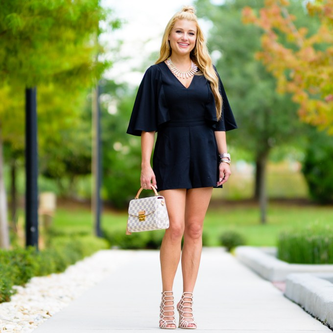 cape, romper, louis vuitton handbag, steve madden heels, slithur, kendra scott necklace, statement necklace