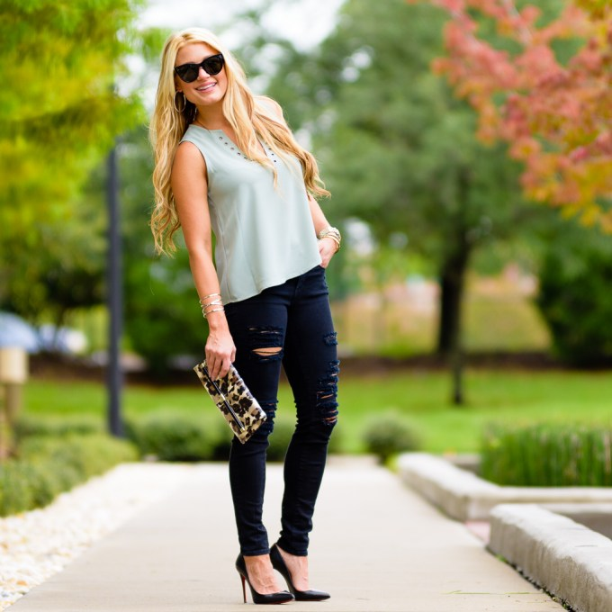 mint green top, black ripped denim, leopard clutch, leopard accent, black pumps, christian louboutin, pigalle, chloe and katie