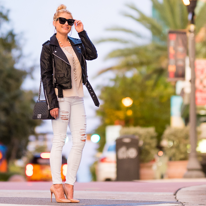 black leather moto jacket, blanknyc, faux leather, white denim, ripped denim, blush camisole, silk cami, celine sunglasses, chanel handbag, chanel boy, christian louboutin shoes, pigalle pumps, nude pumps, chanel pearls