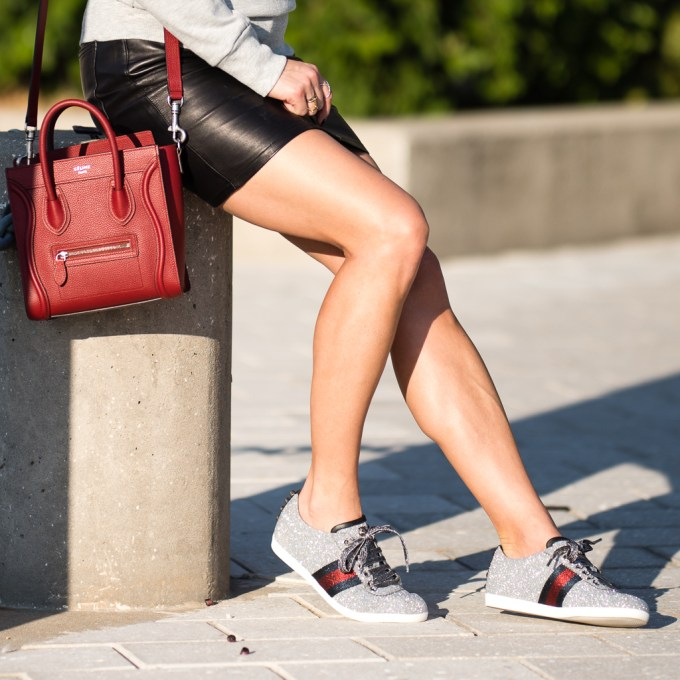 black leather skirt, gucci shoes, gucci sneakers, topshop, sweatshirt, celine nano, kapten & son sunglasses