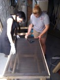 Laying down the perforated metal sheet with Emma. Photo by Adam.