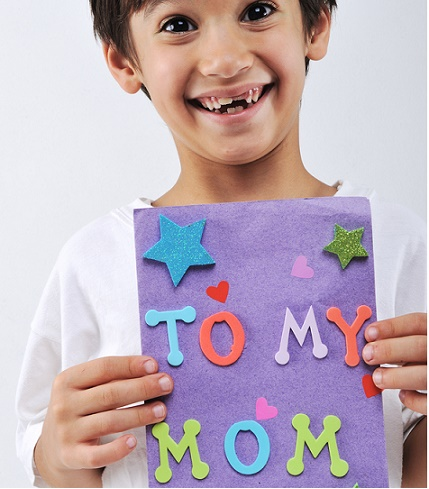 Boy holding a Handmade Mothers Day greeting card