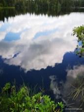 Wolken im Etang de la Gruère