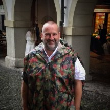 Smiling in the rain (in a Swiss army poncho!)